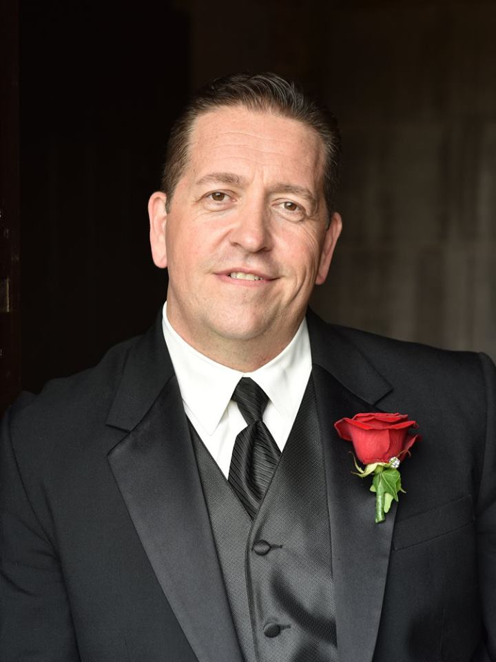 Father of the bride wearing a rose boutonniere