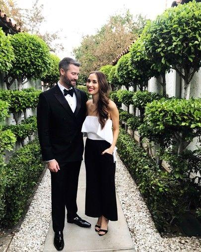Couple wearing black tie optional dress code.