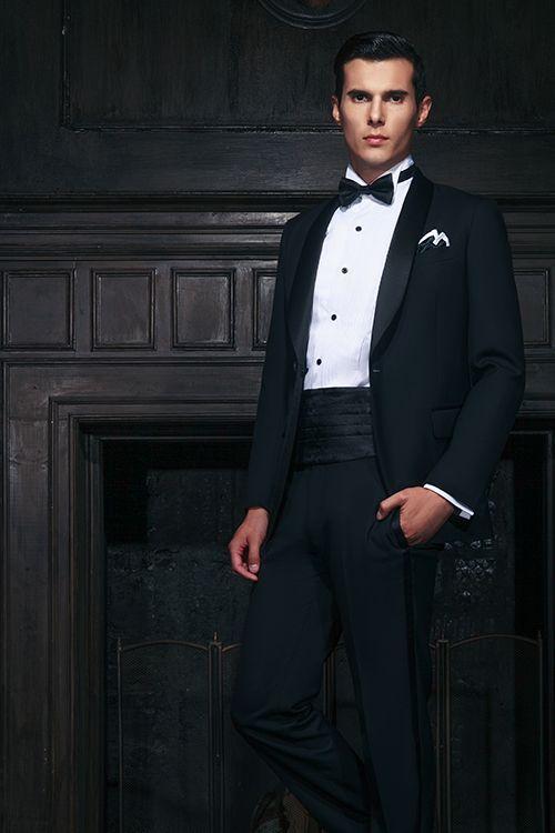Man wearing a tuxedo with a cummerbund.