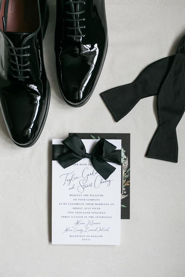 Save The Date with groom's shoes and bowtie