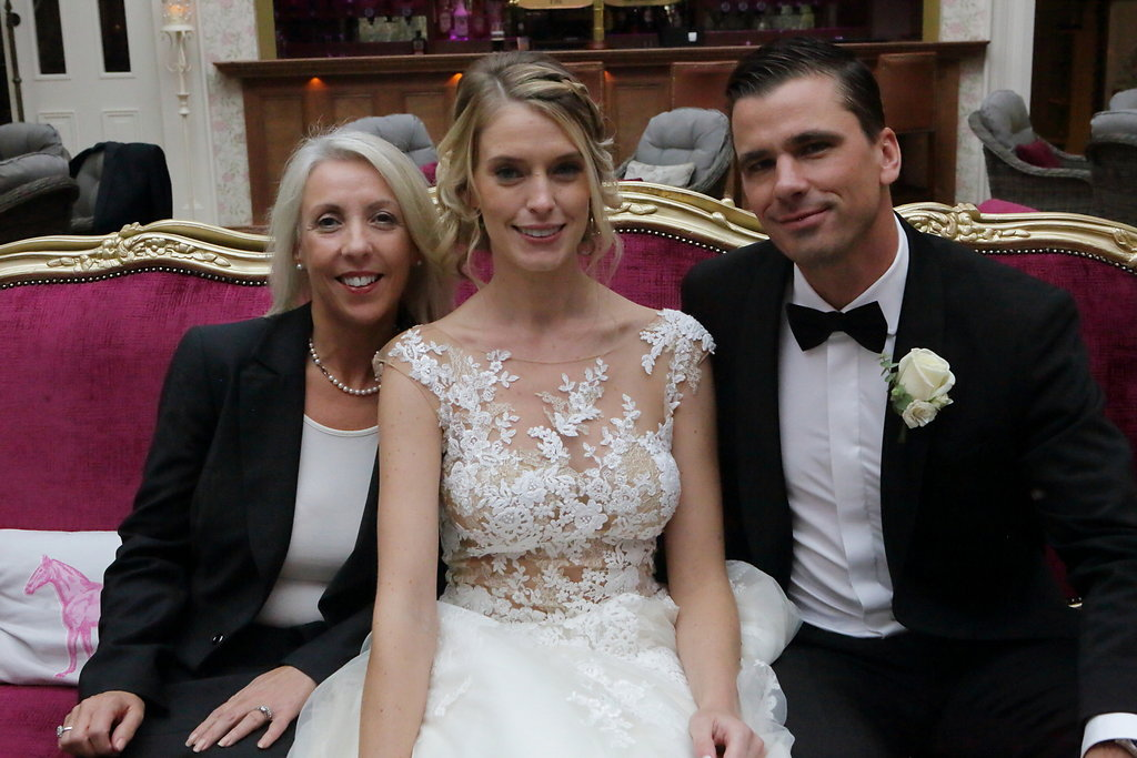 Michelle with bride and groom
