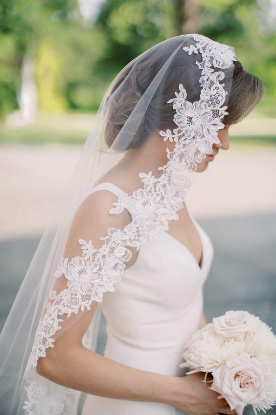 Bride wearing a mantilla veil.