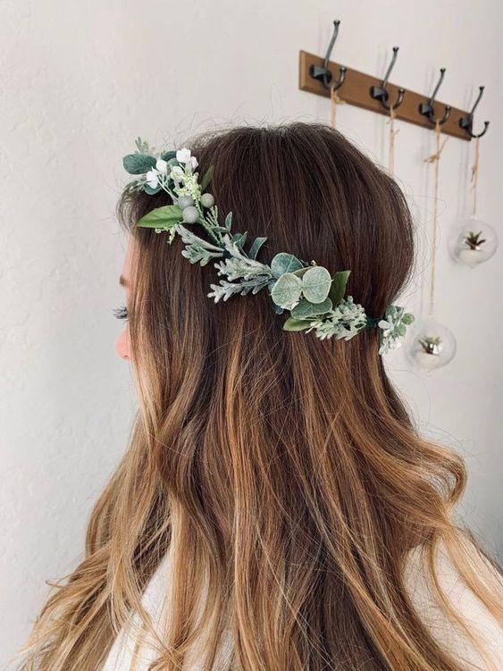 Woman wearing a wreath on her head.