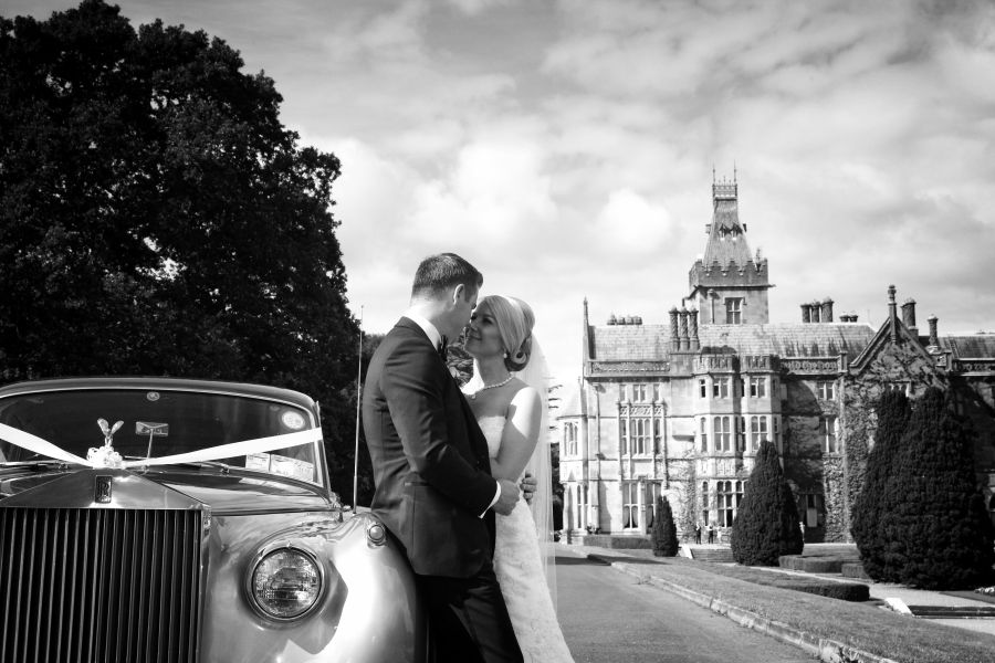 Couple kissing in front of an Irish castle