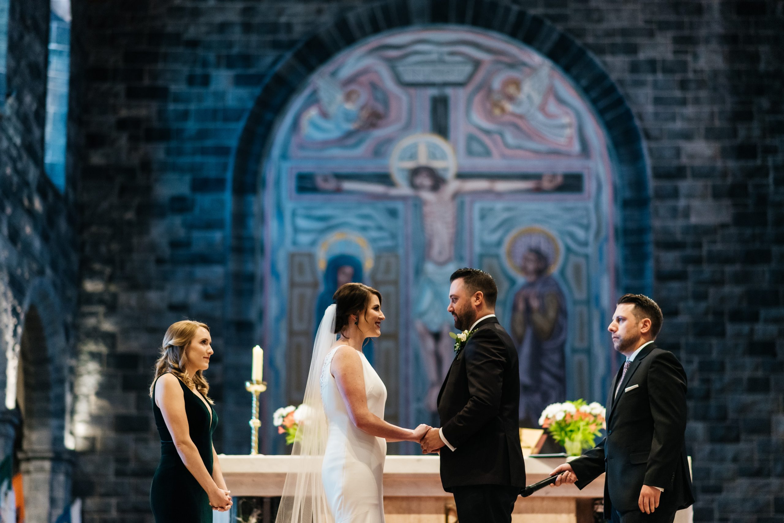 Couple on tha altar with witnesses