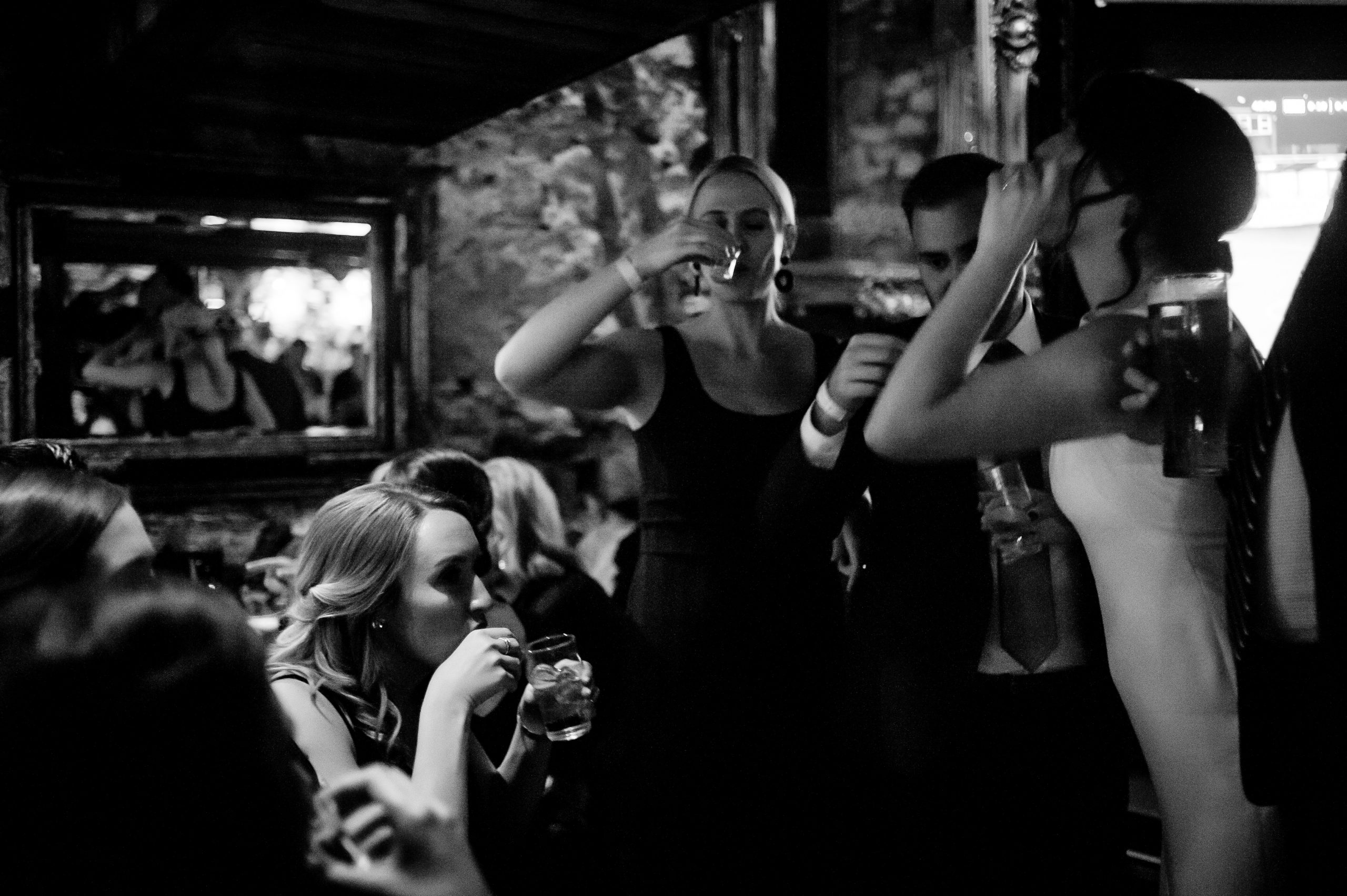 Bride taking a shot with her Bridesmaids