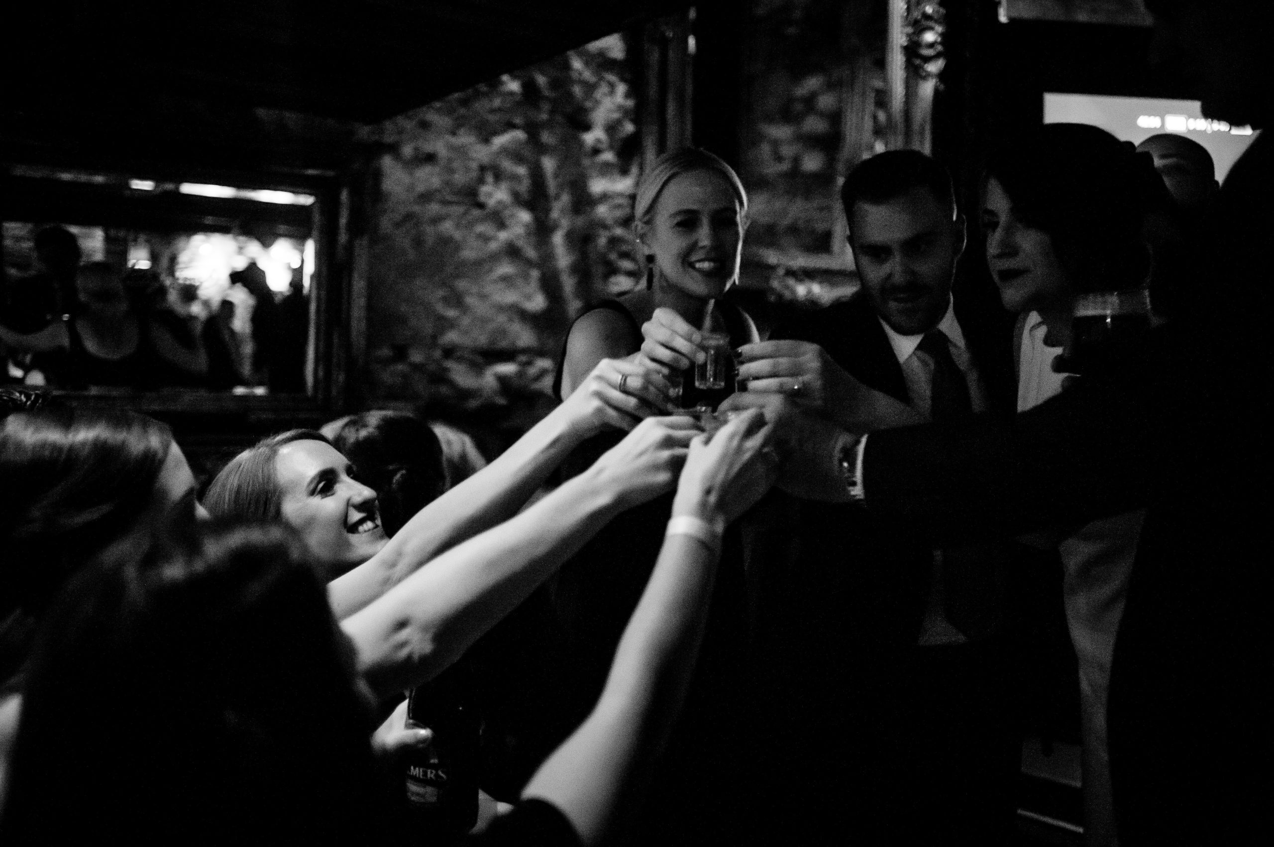 Bride taking a shot with her Bridesmaids at the pub