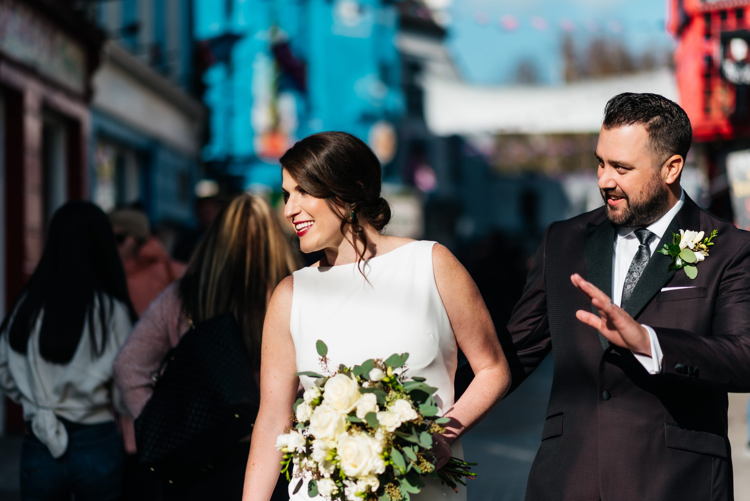 Couple waving on the streets of Galway City