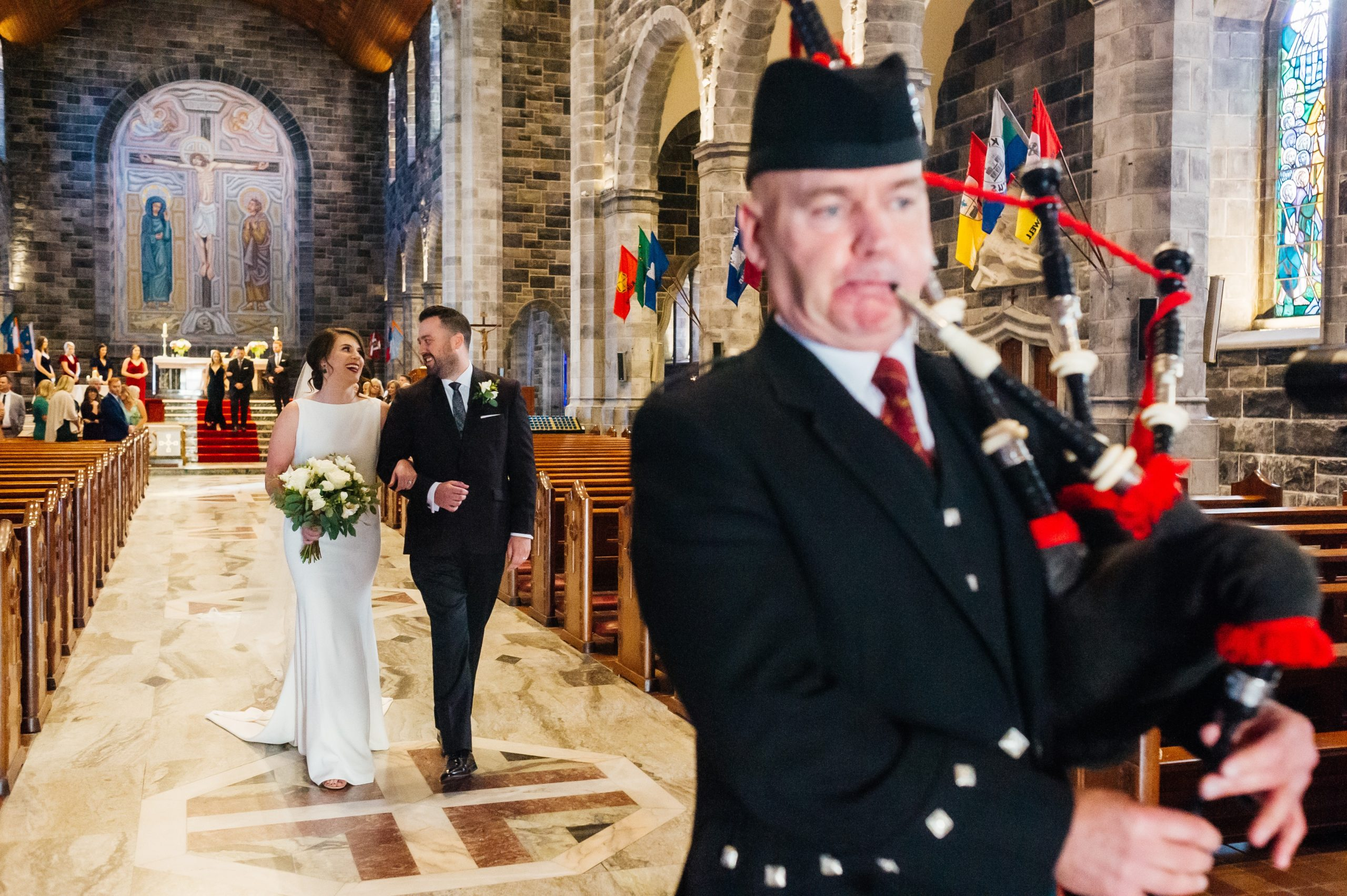 The Bagpiper leading the couple down the aisle